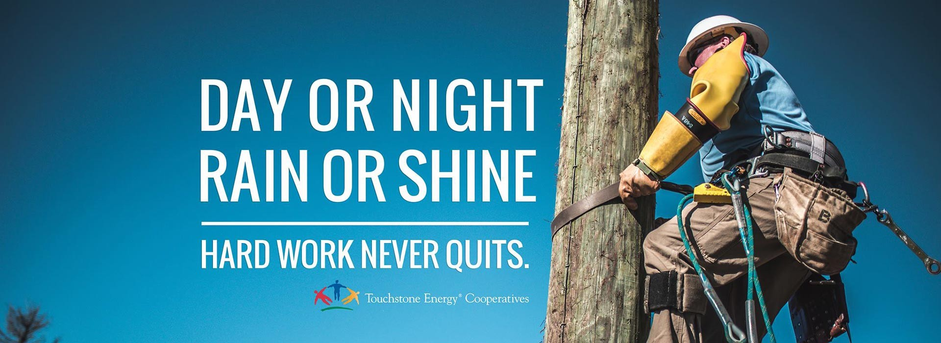 Day or night, rain or shine, hard work never quits. (Man working on power pole)