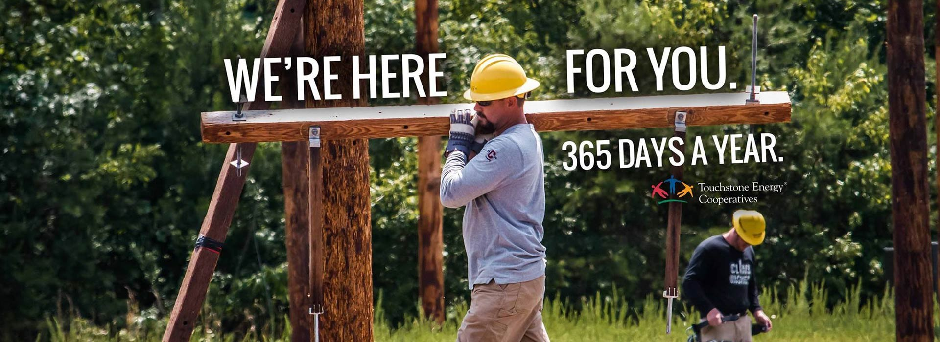 We're here for you. 365 Days a Year. (Man working on power pole)